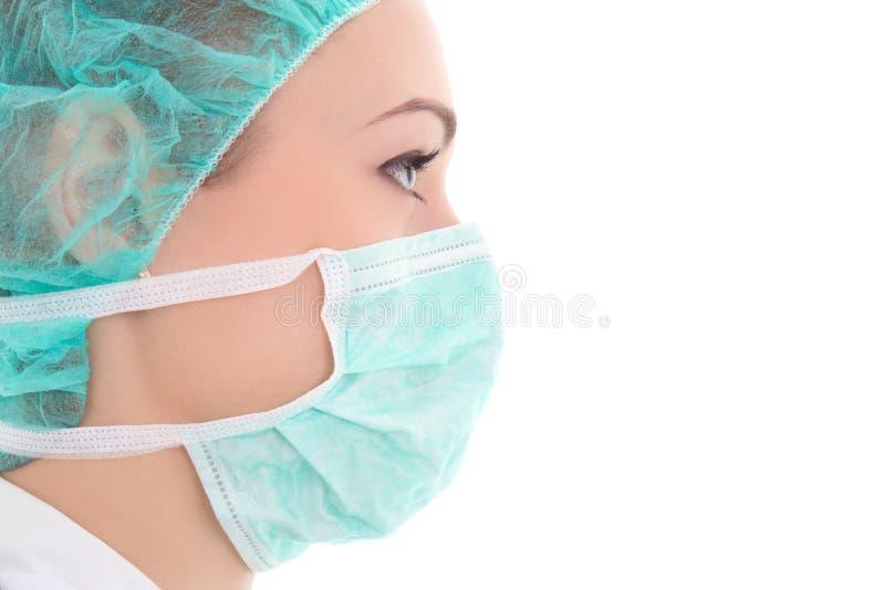 Schließen Sie herauf Porträt der jungen Ärztin in der Chirurgmaske stockfoto