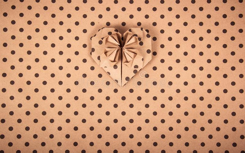 Schließen Sie herauf Schuß Herzorigami Papiertupfen Gekrümmte (Papier) Beschaffenheit stockfotos