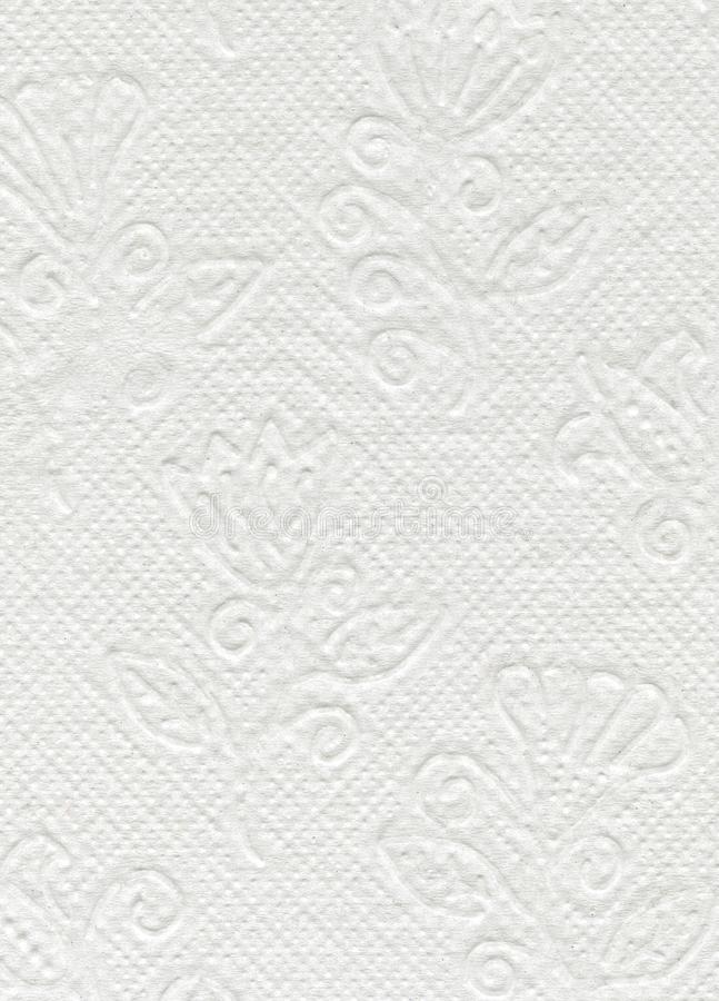 Schließen Sie herauf weiße Toilettenpapierbeschaffenheit Weißes strukturiertes WC-Papier mit Blumenverzierung stockfotografie