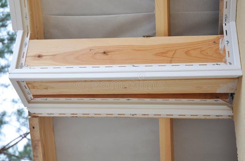 Schließen Sie oben auf Install Laibung Deckungs-Bau Laibung und Binde lizenzfreie stockfotografie