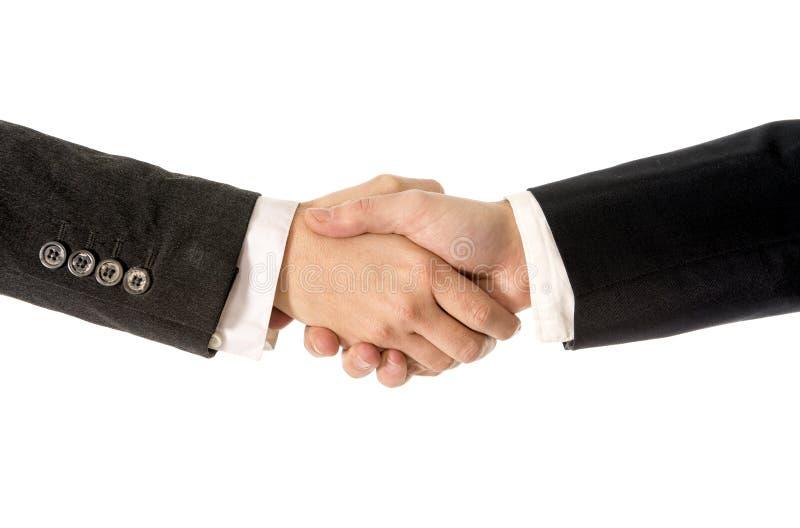 Schließen Sie oben vom Geschäftsmann, der Hand mit Geschäftsfrau rüttelt stockbild