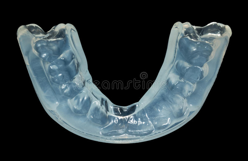 Schließen Sie oben vom lokalisierten Zahnschutz lizenzfreie stockfotografie