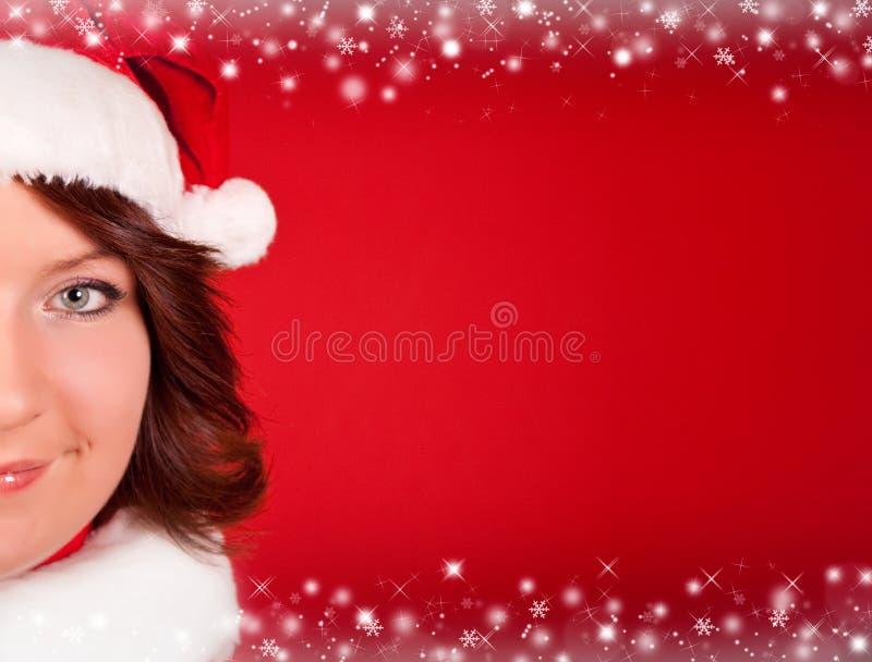 Schließen Sie oben vom netten Mädchen im Weihnachtsmann-Tuch lizenzfreie stockbilder