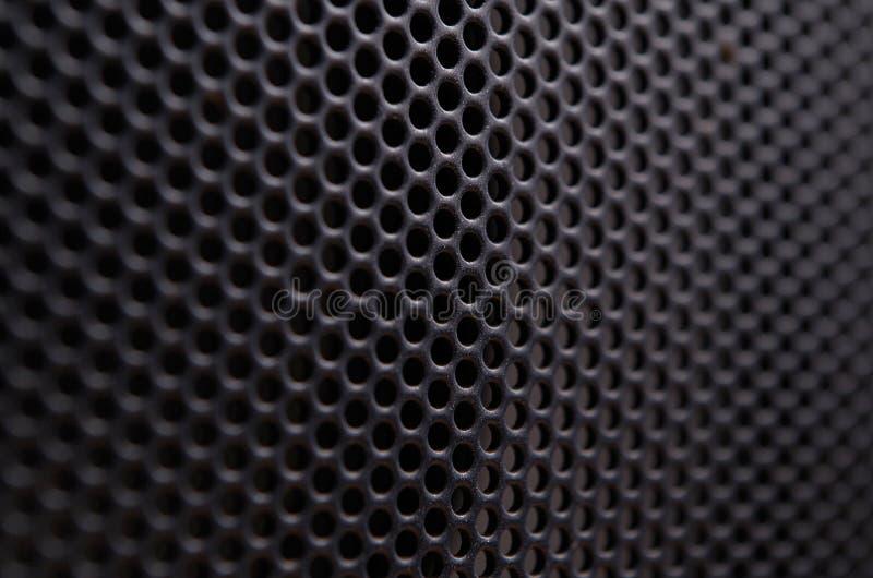 Schließen Sie oben vom Sprecherschwarzmetallgitter stockbild