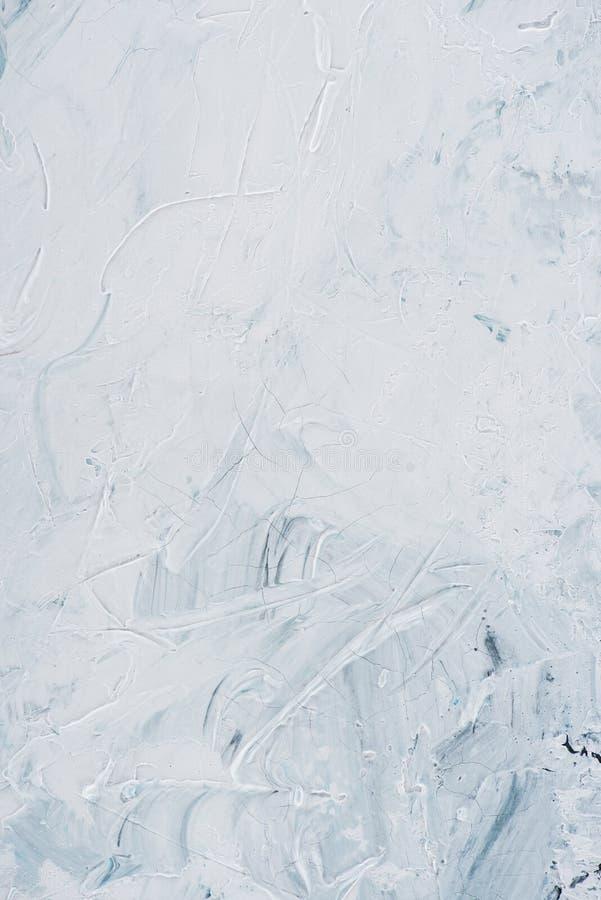 Schließen Sie oben von den weißen Bürstenanschlägen der Ölfarbe stockfotografie