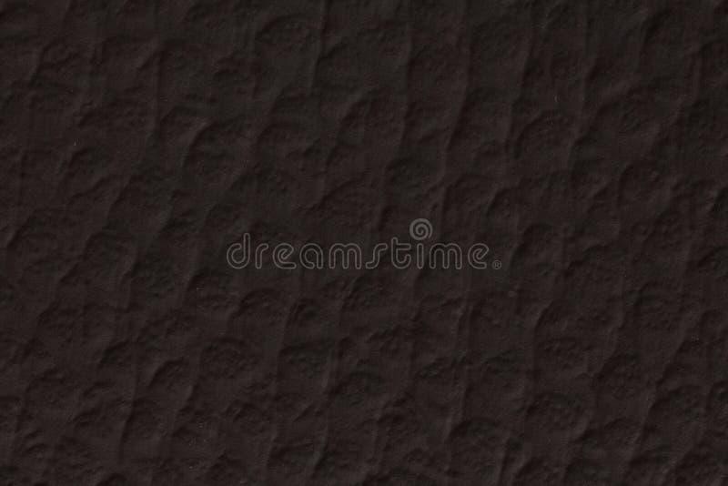 Schließen Sie oben von der Papierbeschaffenheit - schwarzer Kraftpapier-Blatthintergrund stockbild