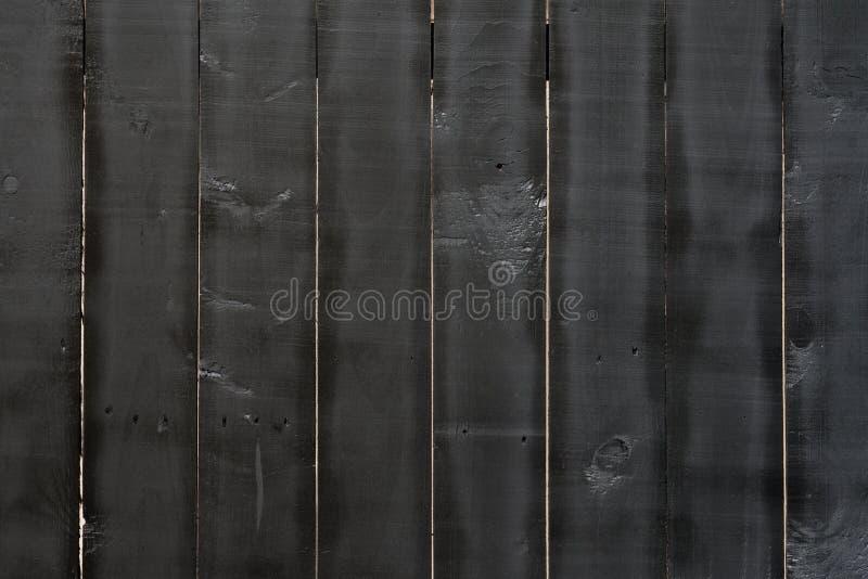 Schließen Sie oben von der schwarzen alten hölzernen Wandbeschaffenheit lizenzfreie stockbilder