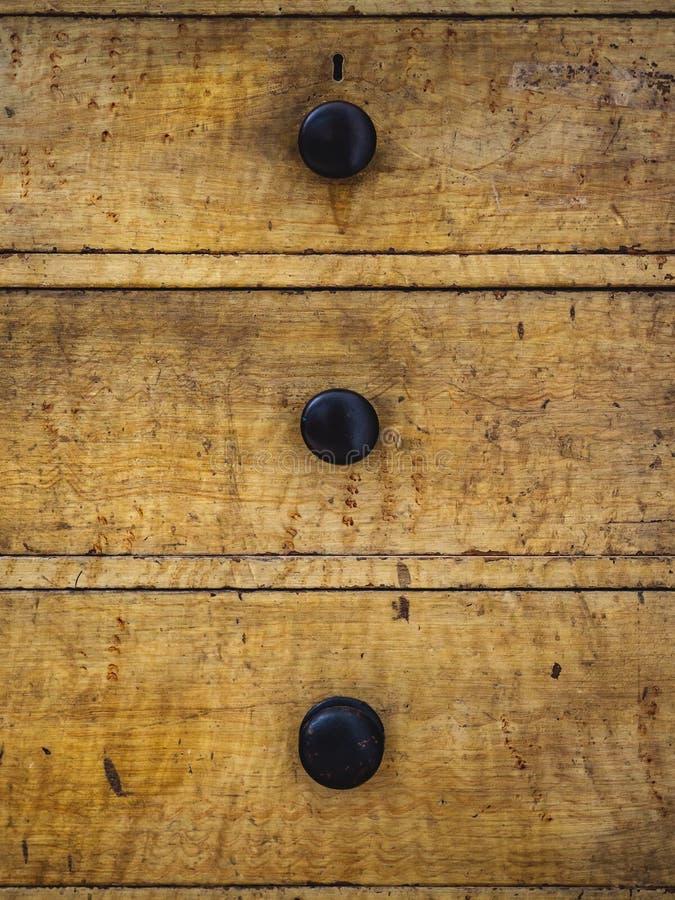 Schließen Sie oben von drei rustikalen hölzernen Fächern eines antiken Aufbereiters lizenzfreie stockbilder