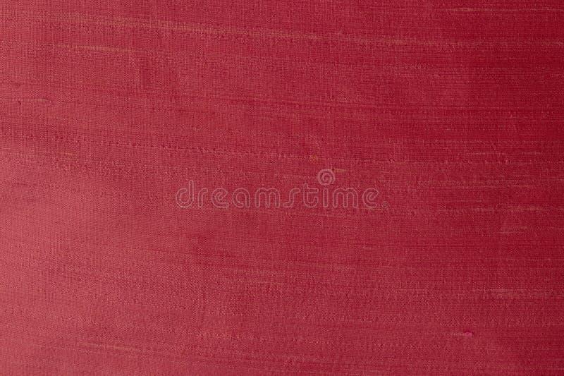 Schließen Sie oben von einem woolen Gewebe der roten violetten Farbe Abstrakter Segeltuchhintergrund, leere Schablone stockbild