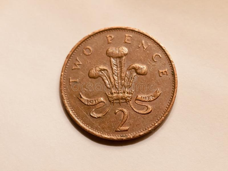 Schließen Sie oben von Münzen-Großbritannien-Währung der Pennys Englisch zwei brauner lizenzfreies stockfoto