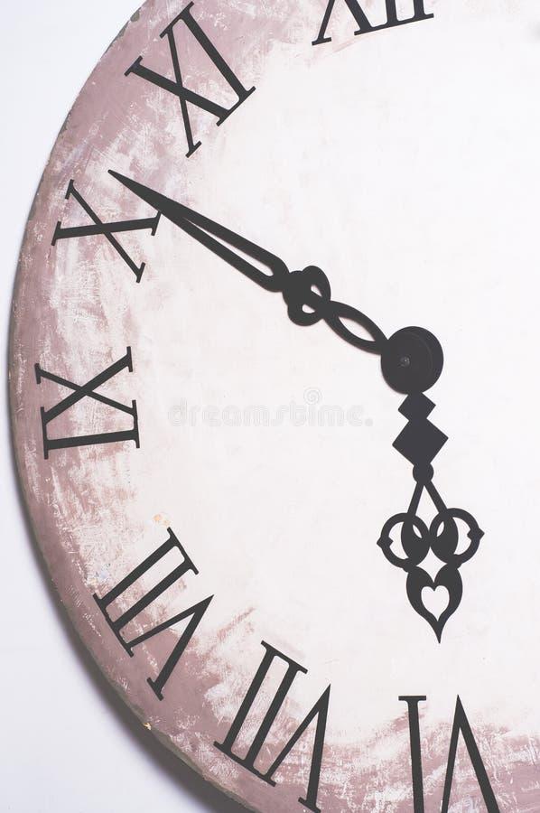 Schließen Sie oben von Roman Numeral Clock Face lizenzfreies stockfoto
