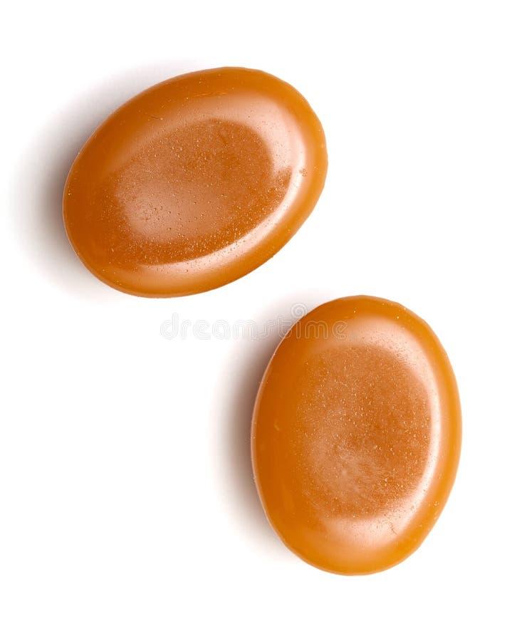 Schließen Sie oben von zwei Karamellsüßigkeiten lizenzfreies stockbild