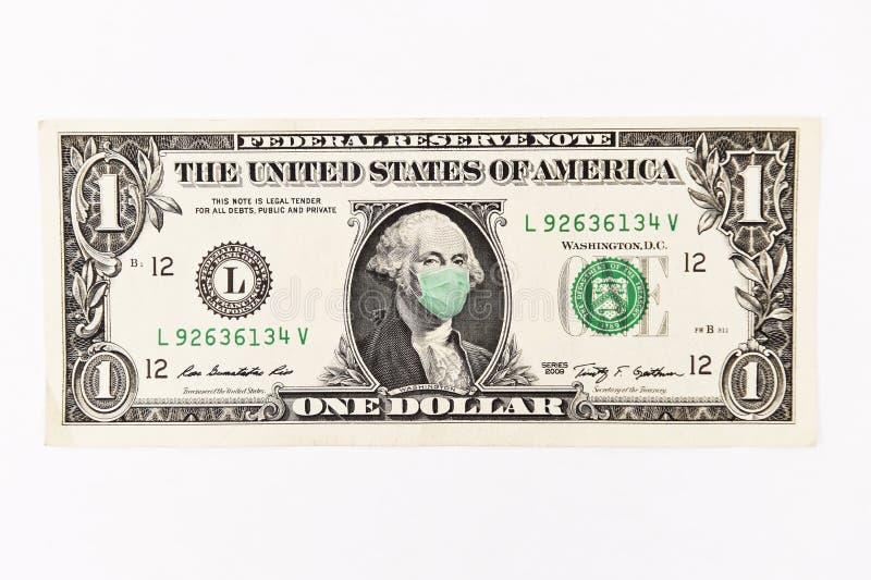 Schließung einer Geldrechnung mit Gesichtsmaske stockfotos