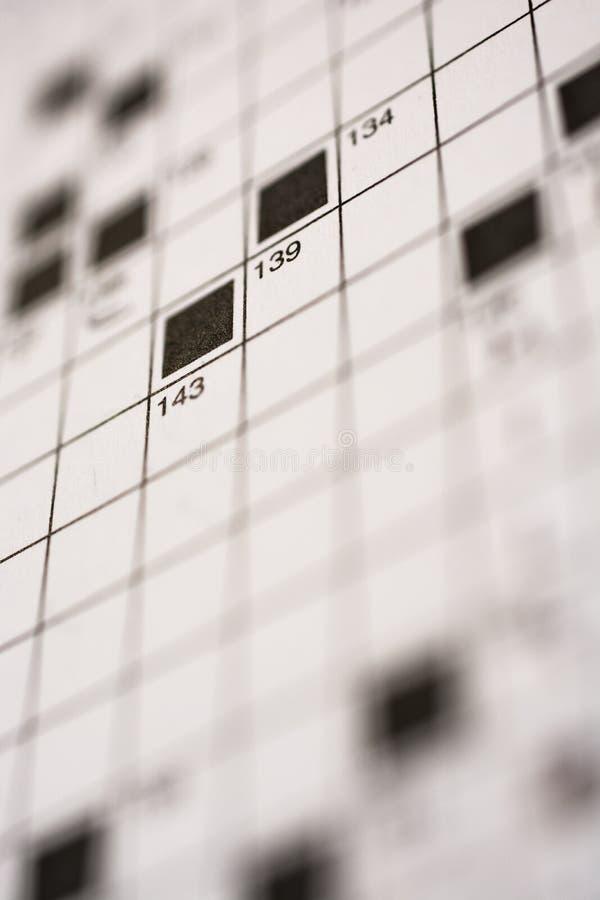 Schließen Sie oben vom Kreuzworträtsel stockbilder