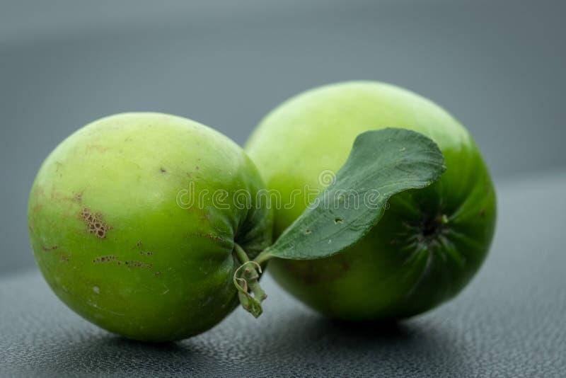Schließen Sie oben von den grünen indischen Brustbeeren stockbild
