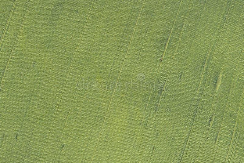 Schlie?en Sie oben von einem woolen Gewebe der gr?nen Farbe Abstrakter Segeltuchhintergrund, leere Schablone stockbilder