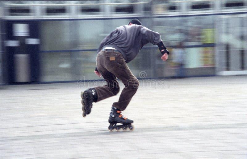 Schlittschuhläufer Blured - Filmkorn Lizenzfreie Stockfotos