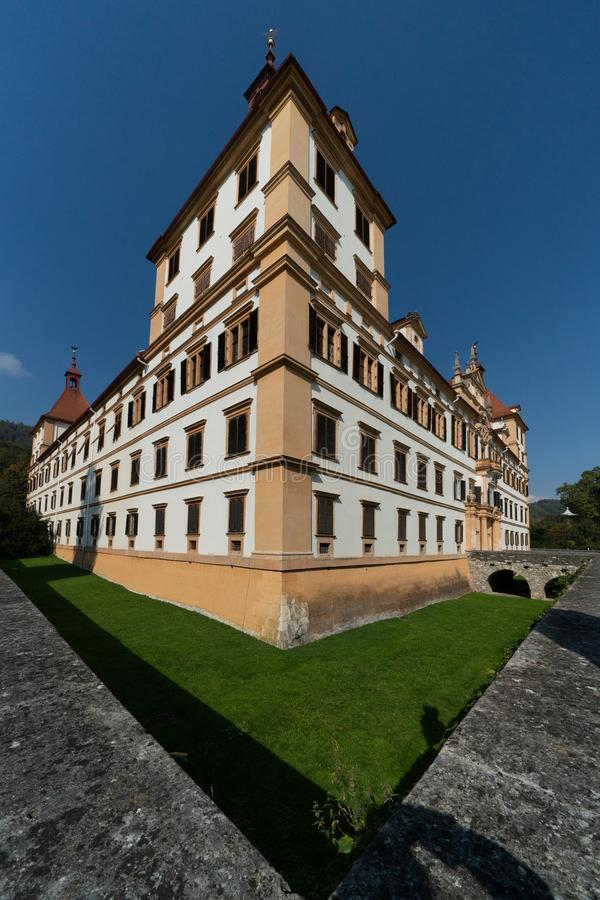 Schloss Eggenberg, Graz. The Eggenberg Palace in Graz, which is built to represent an exact calendar and the cosmic world. It`s moat now a green grassed space stock images