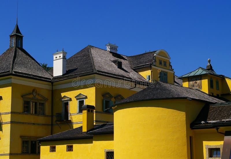 Schloss Hellbrunn near Salzburg Austria. The distinct yellow color sets Hellbrunn apart as a whimsical summer palace. Hellbrunn is famous for its fantastic and stock photo