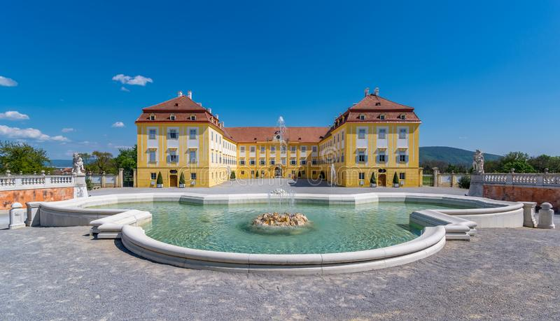 Schloss Hof castle. Schloss Hof Palace front facade with beautiful fountain and blue sky royalty free stock photo