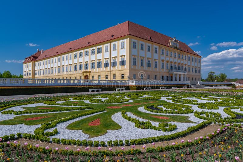 Schloss Hof castle. Schloss Hof Palace with beautiful formal garden and blue sky royalty free stock images