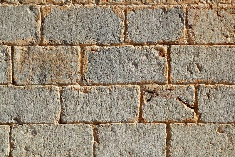 Schlossmaurerarbeitwandgeschnitzte Steinreihen stockbild