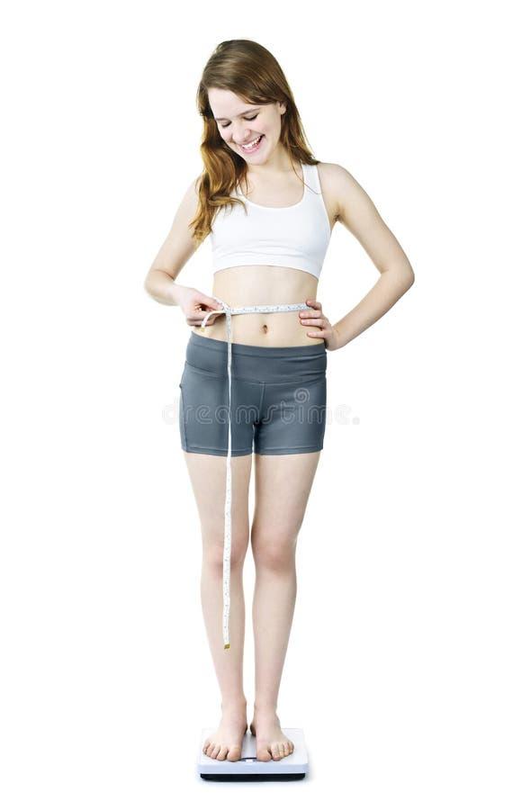 Schlusses Gewicht des jungen Mädchens stockbild