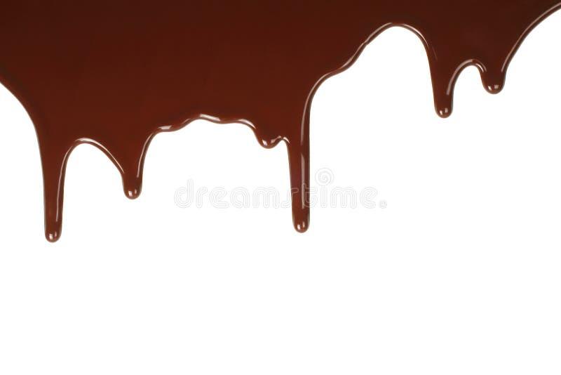 Schmelzendes Schokoladenbratenfett stockfoto