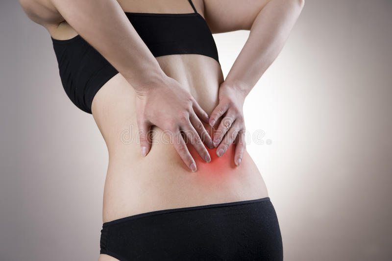Schmerz auf der Rückseite der Frauen stockfotos