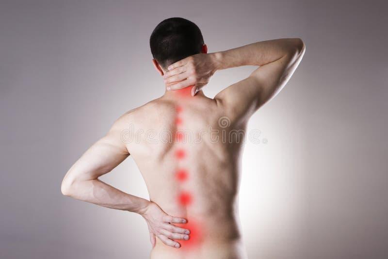 Schmerz in einem Körper des Mannes stockfotografie