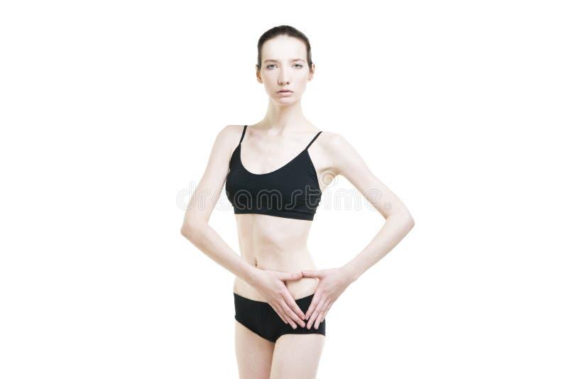 Schmerzen Sie in der linken Seite des Frauenkörpers lizenzfreies stockbild