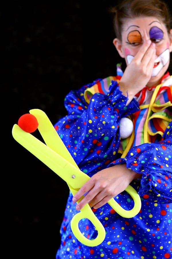 Schmerzender dummer Clown stockbild