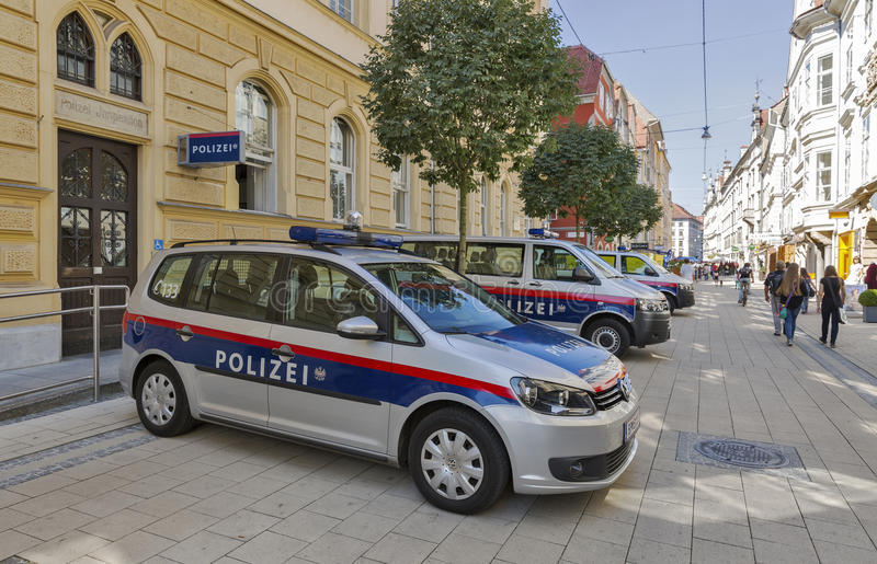 Schmiedgasse street in Graz, Austria. Unrecognized people walk along Schmiedgasse street and local police station in Graz Old Town. Graz is the capital of Styria stock image