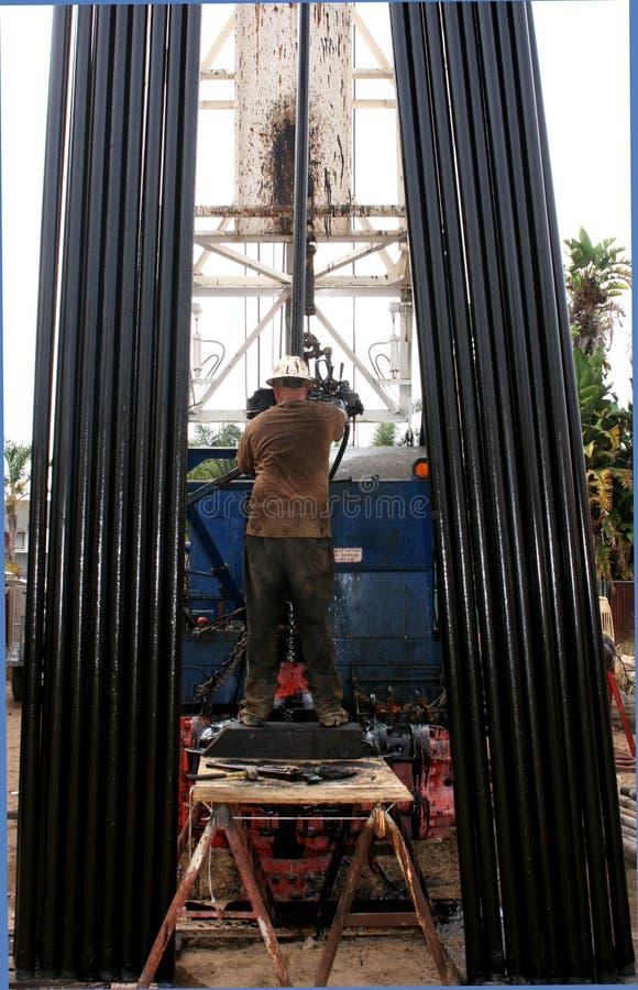 Schmierölbohrgerätbediener stockfotos