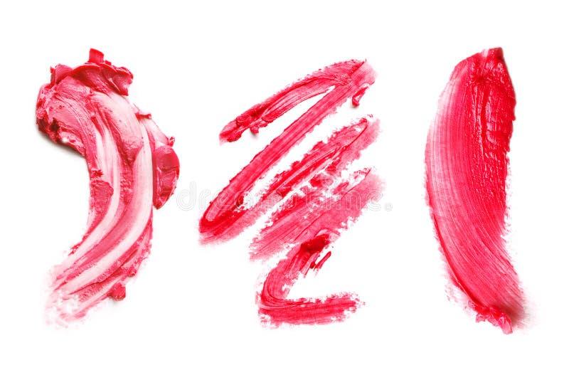 Schmiert Lippenstift auf einem weißen Hintergrund lizenzfreie stockfotografie