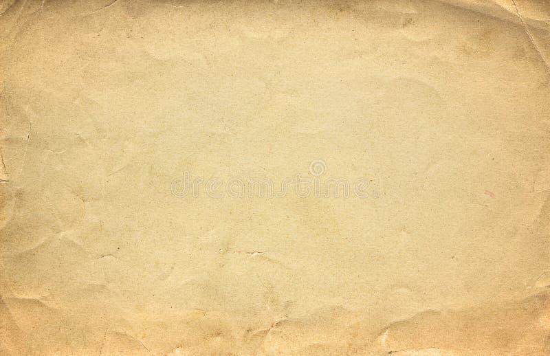 Schmutzbraune alte Papierbeschaffenheit oder -hintergrund mit Vignette stockfotos