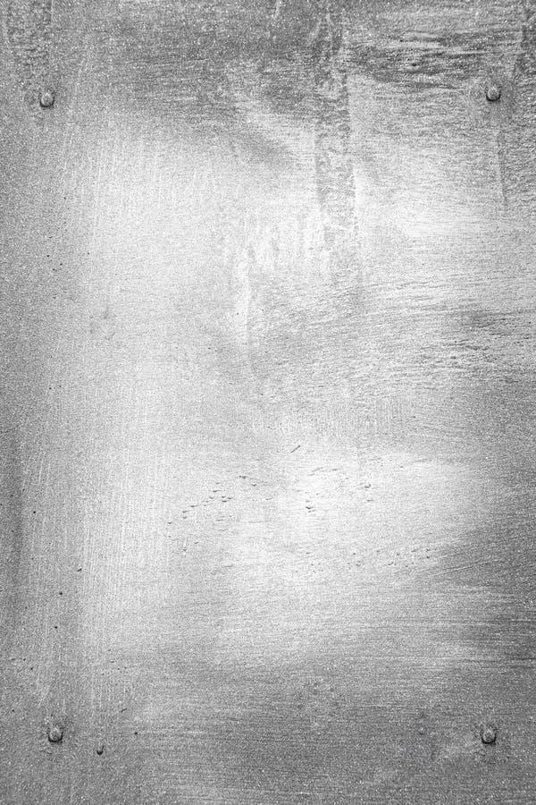 Schmutzhintergrund Metallplatten mit Schrauben lizenzfreies stockbild