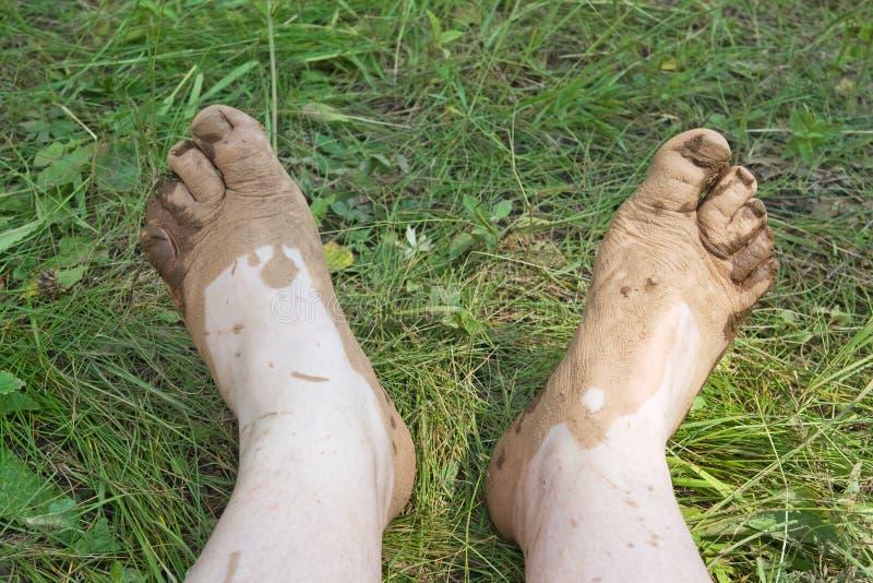 Schmutzige Füße stockbilder