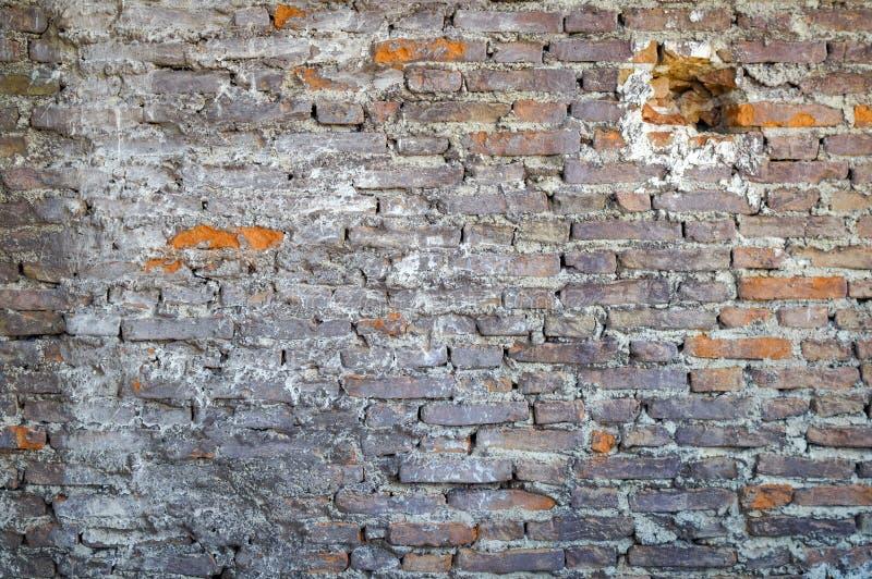 Schmutzige geräucherte Backsteinmauer lizenzfreies stockbild