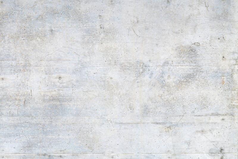 Schmutzige graue Betonmauer stockfotografie