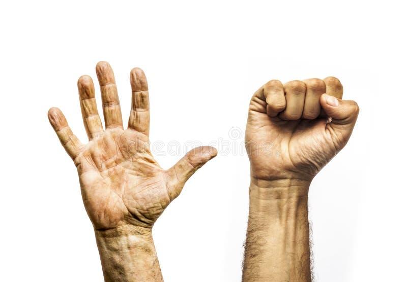 Schmutzige Hände der Arbeitskraft, offene Palme und Faust stockfotos