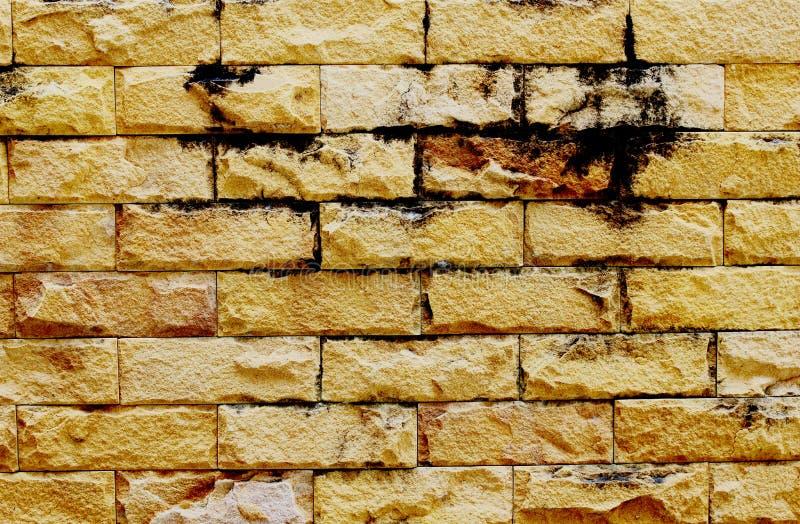 schmutzige Steinbacksteinmauer stockbild