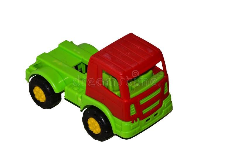 Schmutziger benutzter Spielzeugauto-LKW lokalisiert auf wei?em Hintergrund stockbilder