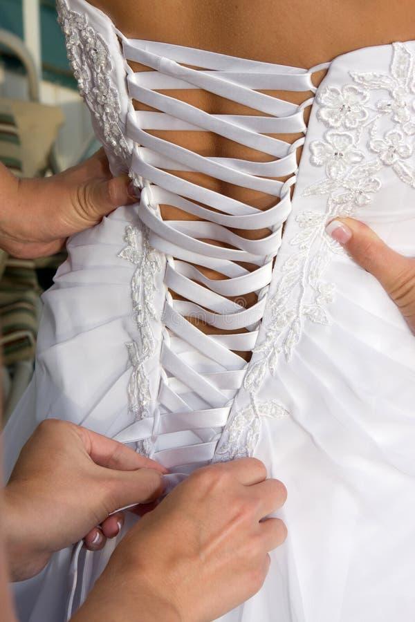 Schnüren-Hochzeits-Kleid stockbilder