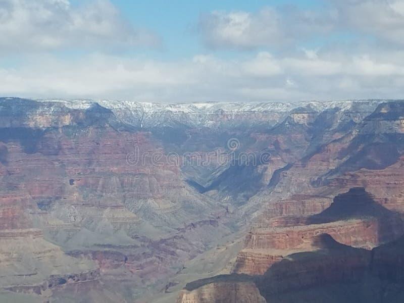 Schnee mit einer Kappe bedeckter Berggrand Canyon lizenzfreies stockfoto