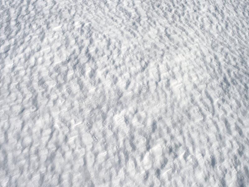 Schnee mit hellen Reflexionen von der Wintersonne lizenzfreie stockfotografie