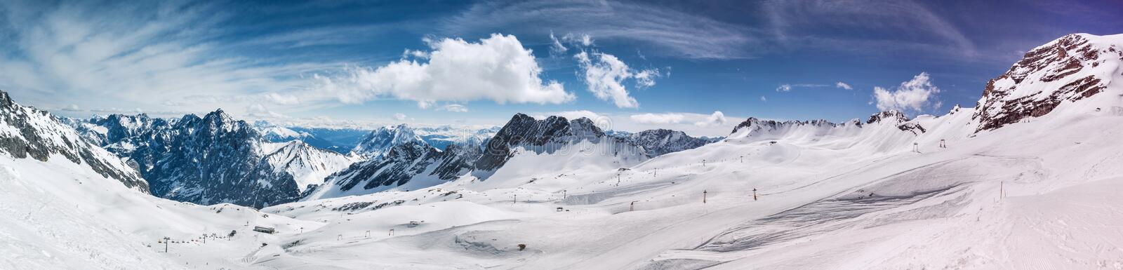 Schneeferner glacier and the alps in the background high definition panorama in the winter. The schneeferner glacier and the alps in the background high stock photo