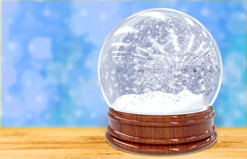 Schneekugel auf Schreibtisch stockbild