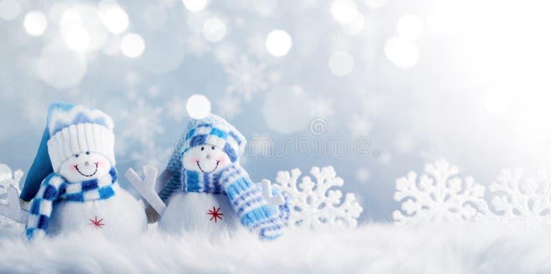 Schneemann- und Weihnachtsdekorationen lizenzfreie stockbilder