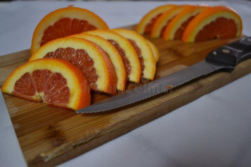 Schneiden Sie frisch Orangen stockbild